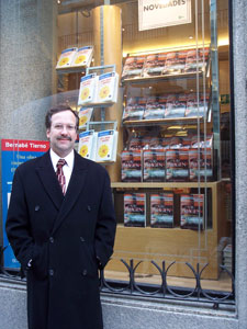 The author in Madrid, Spain, in front of a store window display of his novel A Su Imagen (In His Image).